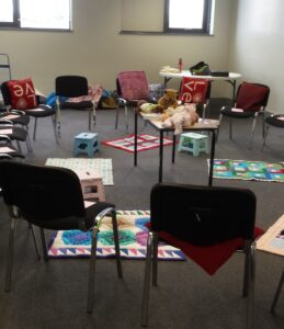 room full of chairs waiting for mums , babies and breastfeeding supporters